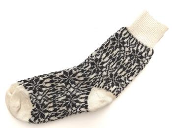 Myk strikkesokk laget av 100 % økologisk sertifisert ull (GOTS).