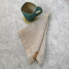 Natural linen napkins and matching linen tablecloths.