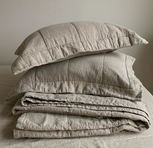 Linoto quilted linen with natural cotton filing.