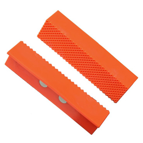 Image of orange Vise Jaw Pads facing each other