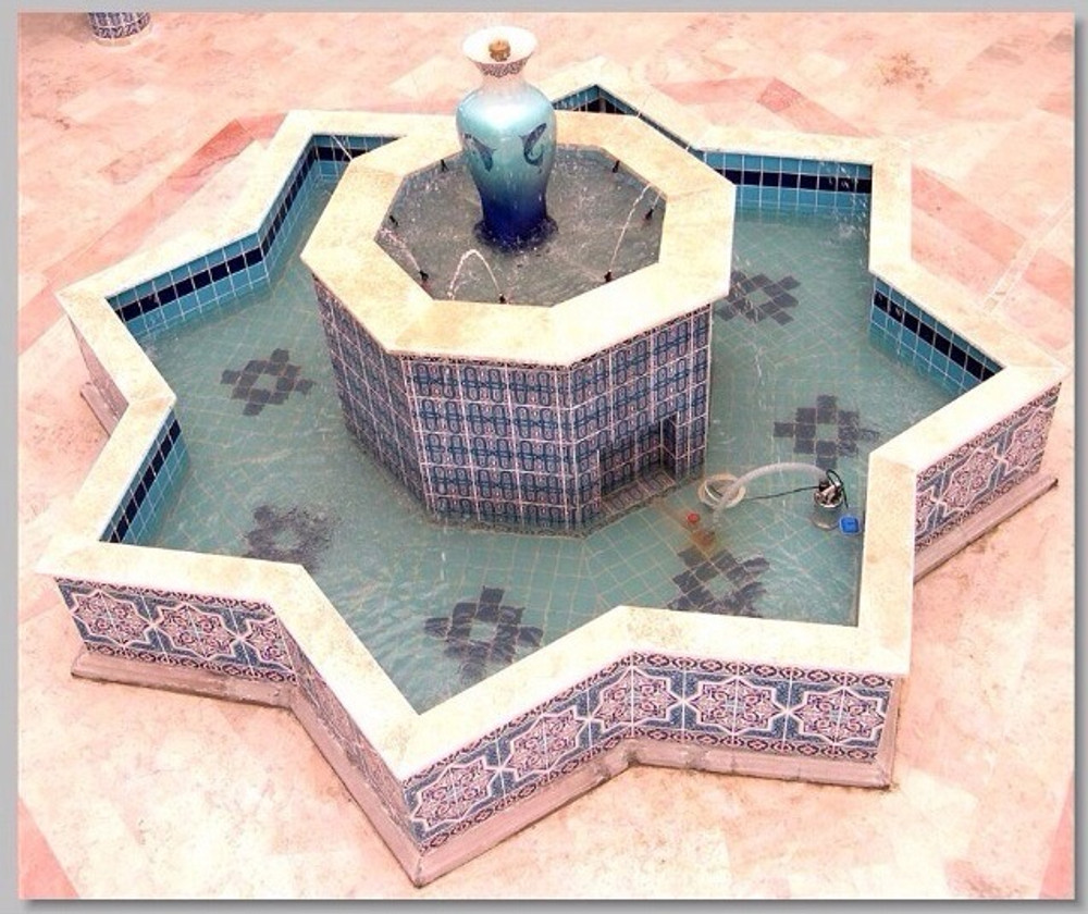 Found in interior portion of fountain along with cobalt tiles