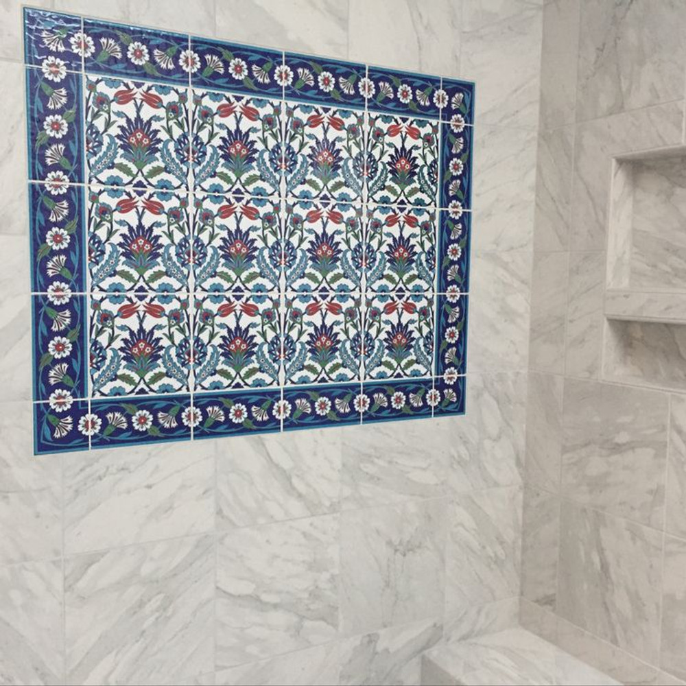 Marble shower with designed bordered ceramic tile .