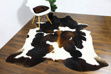 REMOVING LIQUID STAINS FROM A COWHIDES RUGS