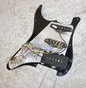 Loaded pickguard with single coil pickups and Jazzmaster style in bridge