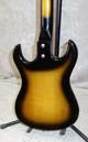 Vintage Custom Kraft electric guitar in sunburst finish with case
