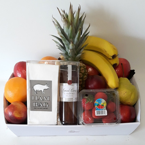 Hamper tray filled with fresh fruit and containing an Ogilvies gift pack of Spiced Citrus and Honey Glaze, together with a ham bag