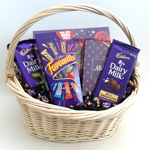 Beautiful basket containing a large box of Roses, Favourites, Chocolate Bars , Milk Tray and Eclairs