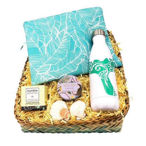 bamboo gift basket with oneloa wet bag, humble botanics bath bomb, whale hydro flask and aloha aina coconut milk tropical scented candle