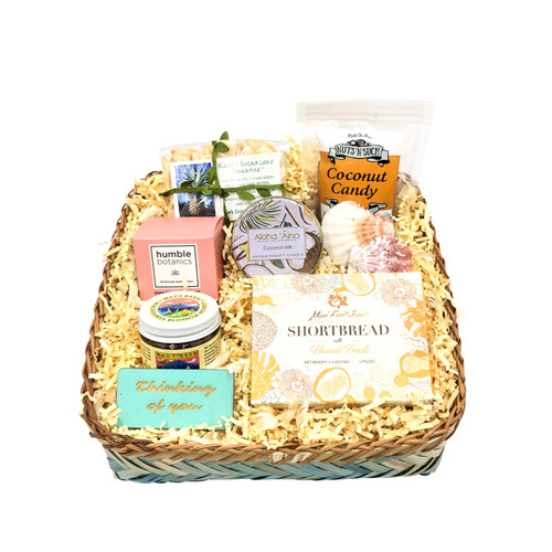 sympathy gift basket with dried kauai pineapple, hawaiian heritage farms  coconut candy, maui fruit jewels shortbread cookies, maui bees honey, humble organics bath bomb, thinking of you sign