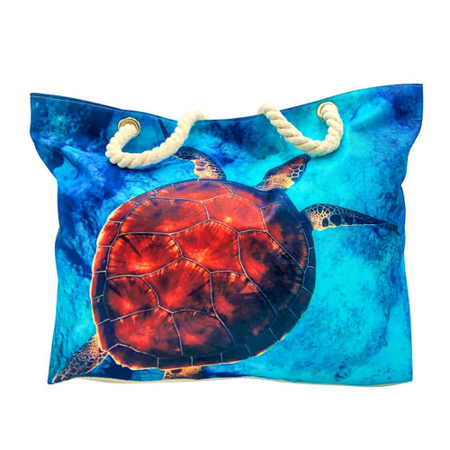 front side image of large canvas beach bag with image of sea turtle swimming in blue ocean