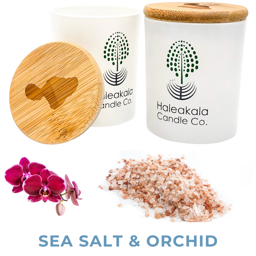 sea salt and orchid organic soy wax candle in glass jar with engraved bamboo lid