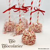 A jumbo marshmallow dipped in white chocolate and smothered with crushed peppermint candy cane. Often used to smash ginger bread houses.  :)-