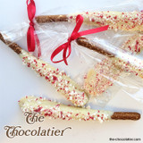 A salty pretzel rod dipped in white chocolate and covered with crushed peppermint candy cane. Wrapped and bowed. The kids & adults love them.