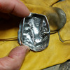 Bull Dog Buckle in sterling silver for 1 .25 bets showing the signed and numbered back