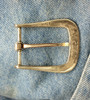 The back of The Farrier Square buckle in bronze shows that each buckle is hand signed and numbered by the artist.
