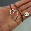 Forged Open Heart pendant on a black cord