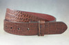 Belt in Brown Genuine embossed alligator textured cow hide belt fits on all 1.25 inch buckles. One piece strap with no stitching. The edges are nicely finished with 2 snaps and a keeper.