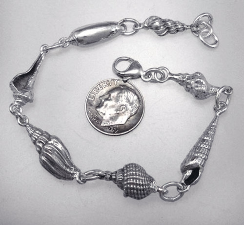 Conch Shell links bracelet.  7 different shells. Solid sterling