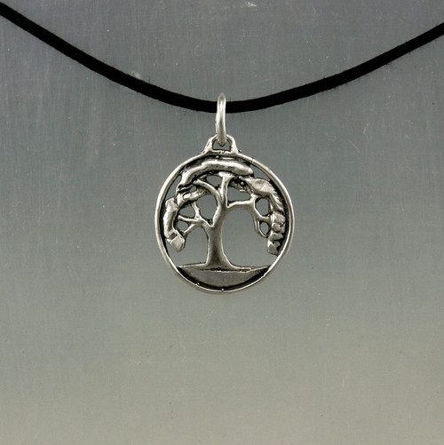 Small oak tree pendant in sterling on a black cotton cord