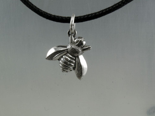"Honey bee pendant shown on a black rubber cord.  Great gift for th bee keeper or the ""honey "" in your life"