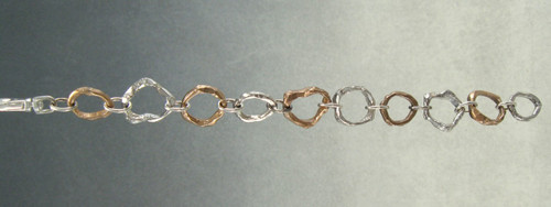 Whittled Sticks links bracelet with all small links in sterling and bronze