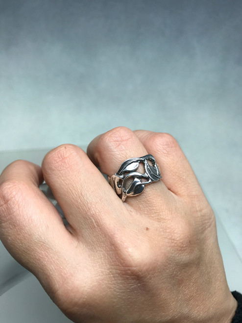 Wide carved leaf and vine ring with pierced sections