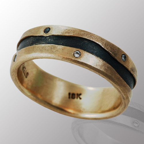 18K yellow gold and silver ring with 10pt. B&W diamonds.