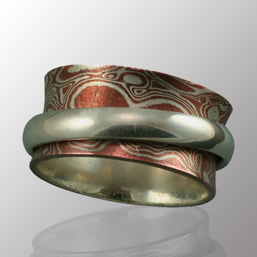 Mokume Gane ring (copper & silver) with a silver band.  10.5mm wide.