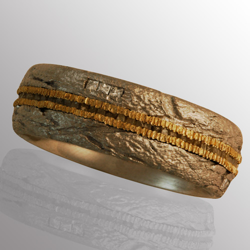 18K yellow gold and palladium ring with 70pt. diamond.  7.5mm wide.