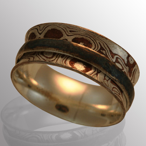 Silver ring with Mokume Gane (silver and copper) on the outside.  10.5mm wide.