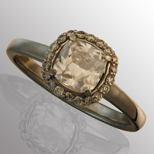 14K white gold engagement ring with 1ct. center diamond and 15pt. side diamonds (G/VS2 with certificate).