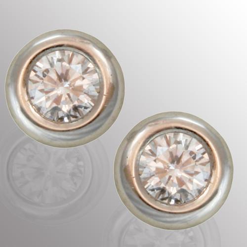 Platinum stud earrings with 40pt. diamond.  5.7mm wide.