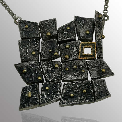 18K yellow gold and sterling silver pendant with 0.15ct. diamond.  40x40mm.