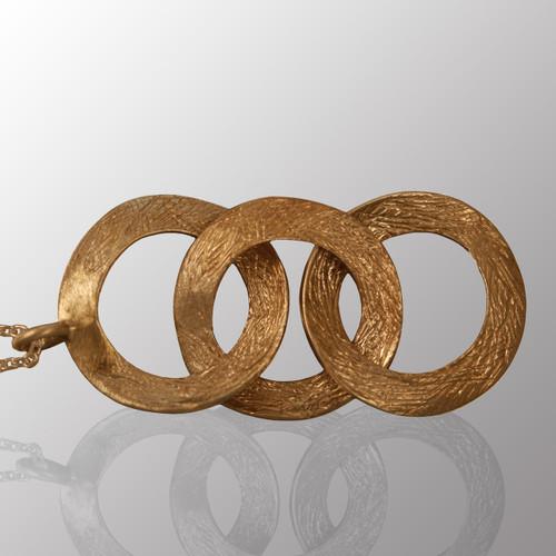 Sterling silver rings pendant.  2.5in. long.