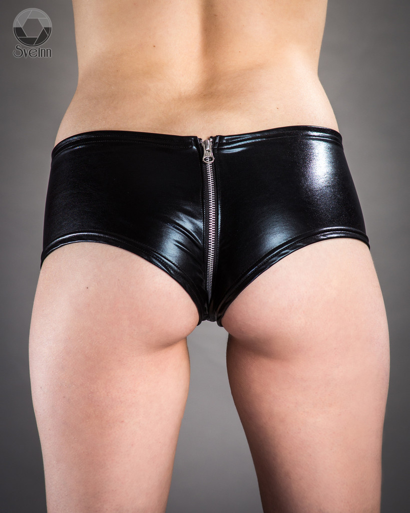 Crotch Zipper Booty Shorts by Mister Pierre  These cheeky peeker style shorts are ideal for discretion when needed and every indiscretion you may desire. They provide coverage when transitioning in between play spaces while allowing for spontaneous sexual access.  A never-fail garment for displaying the assets of a beautiful possession.  Featured in this image:  4-way stretch Gloss Black Vinyl. (Available in all fabrics) Two-Slider crotch zipper for crotch and rear access. Cheeky Peeker style bottom.