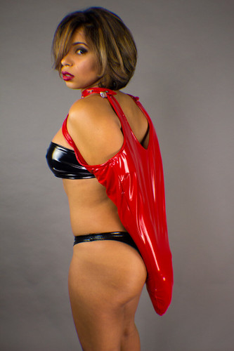 Glossy Vinyl Fetish Arm Binders presented by a female model