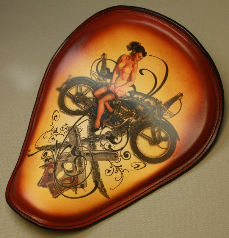 Tattoo seat for a Harley with a Sword Guns Excelsior model tattoo design applied to the leather