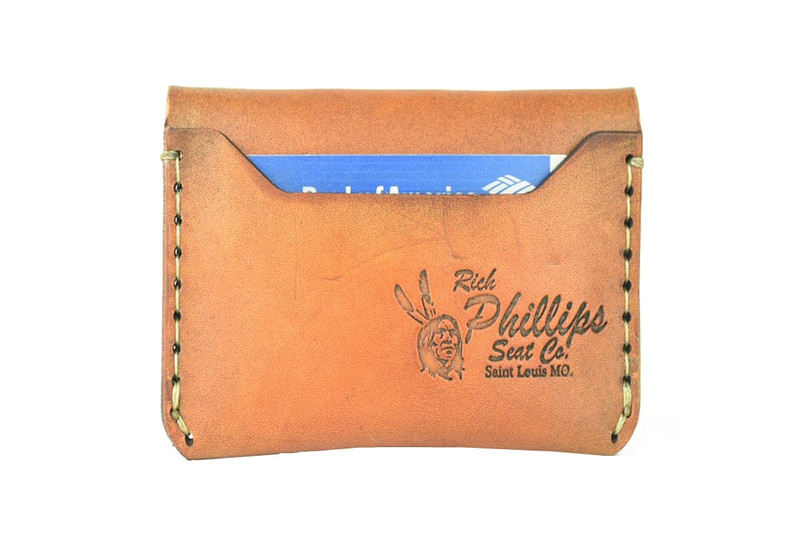 Tom Sawyer Leather Wallet tucked with a business card