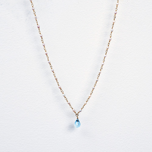 white pearl wrap necklace with blue topaz pendant