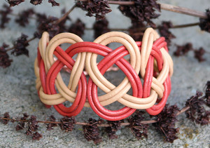 Double Coin knotted bracelet featuring Coral & Peach leather. Copper plated lobster clasp and jump rings create an adjustable size closure.