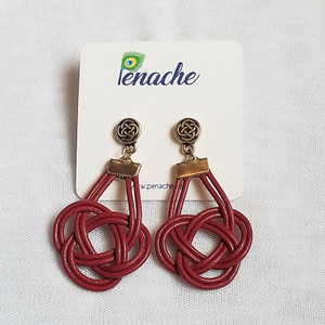 Magenta leather tied into Double Coin knot design with Titanium post for metal sensitive ears. Hangs 2 inches in length