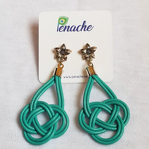 Teal leather tied into Double Coin knot design with Titanium post for metal sensitive ears. Hangs 3 inches in length