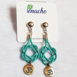 Teal leather tied in Square knot design. Titanium post for metal sensitive ears. Hangs 2 1/2 inches in length.