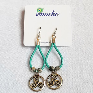 Teal leather with Silver plated Triskele charms. Sterling Silver fish hook posts for metal sensitive ears. Hangs 3 inches in length.