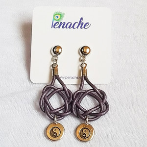 Metallic Purple leather tied in Square Knot design. Titanium posts for metal sensitive ears. Hangs  2 1/2 inches in length.