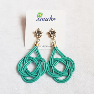 Teal leather tied in Double Coin knot design. Titanium posts for metal sensitive ears. Hangs  2 1/2 inches in length.