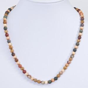 Chic and playful necklace with Red Creek Jasper, wood and gold plated filigree beads. Length 19 inches.