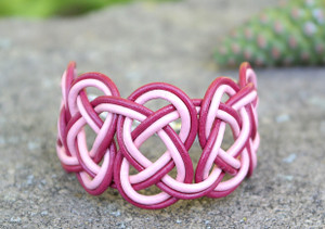 Double Coin knotted bracelet featuring Magenta & Pink leather. Silver plated lobster clasp and jump rings create an adjustable size closure.