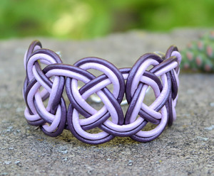 Double Coin knotted bracelet in Metallic Purple and Lilac leather. Silver plated lobster clasp and jump rings create an adjustable size closure.