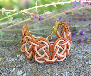 Double Coin knotted bracelet in Tahiti Tan and Peach leather. Gold plated lobster clasp and jump rings create an adjustable size closure.